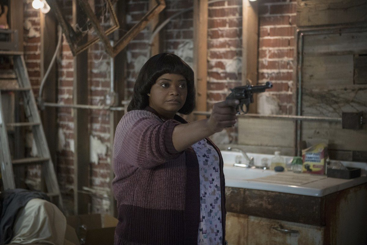 Octavia Spencer holding a gun in a movie Ma (2019)