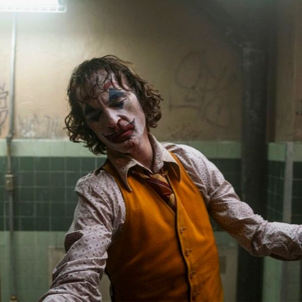 still from joker (2019) where Joker dances in a bathroom