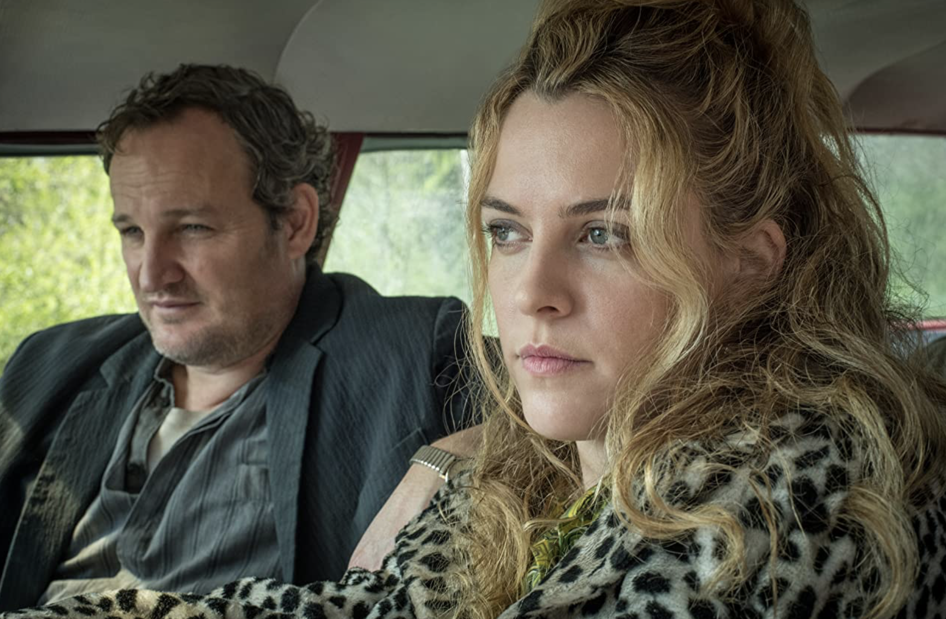 Riley Keough and Jason Isaacs in The Devil All The Time (2020)